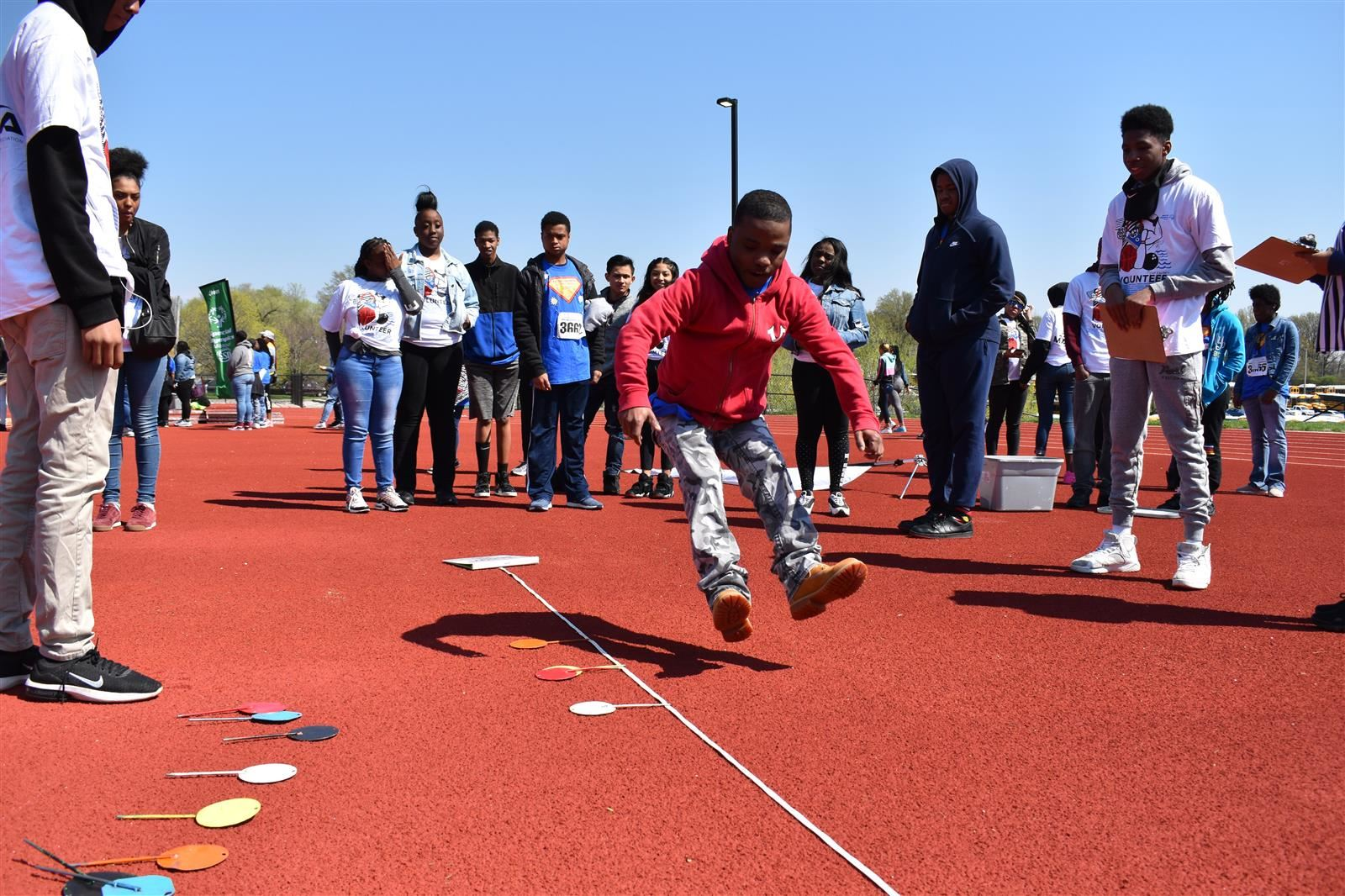 Student participating in long jump competition